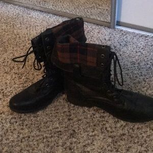 Black combat boots with plaid lining